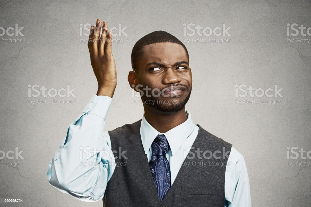 headshot dumb clueless young man, arms out asking what's problem who cares so what stock photo