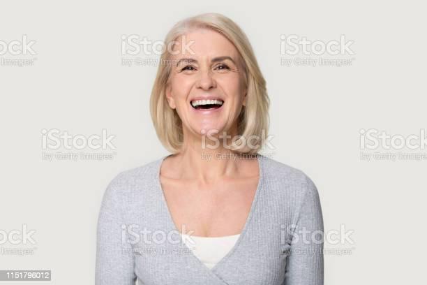 Headshot happy aged female laughing posing on grey studio background picture id1151796012?b=1&k=6&m=1151796012&s=612x612&h=lrv8jypnv2n7bmyrdn lzwzsh59nljqu9nbze50yhpg=