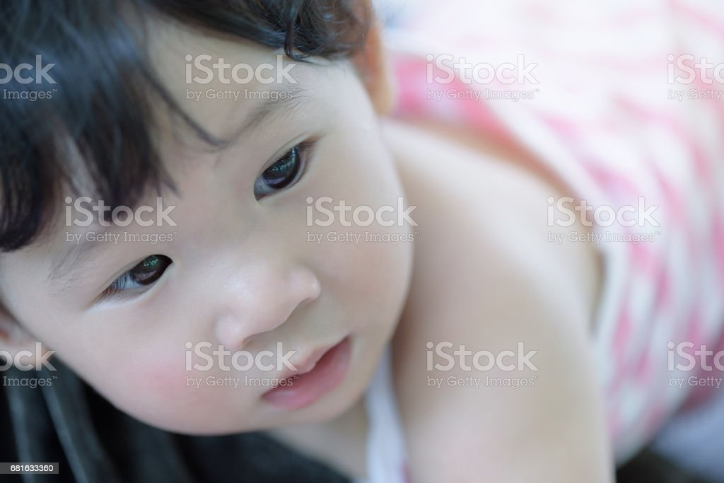 Headshot of cute baby girl in pink. stock photo