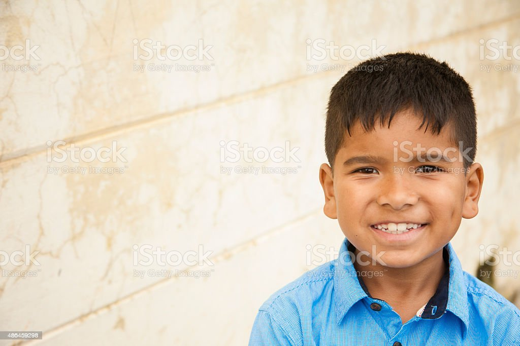 Headshot of cute Latin or Asian boy. Copyspace. stock photo