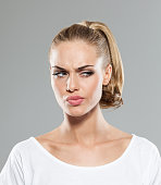 istock Headshot of disappointed blond hair young woman 481811390