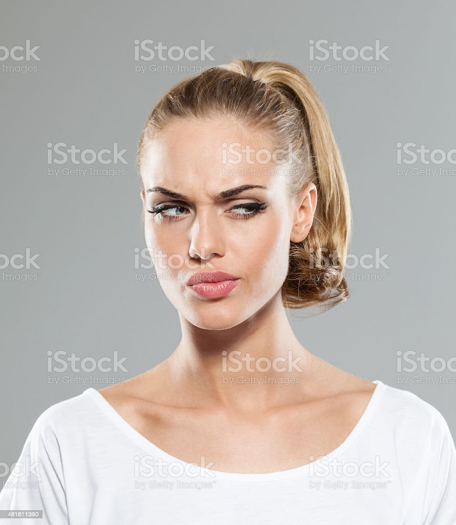 Headshot of disappointed blond hair young woman stock photo