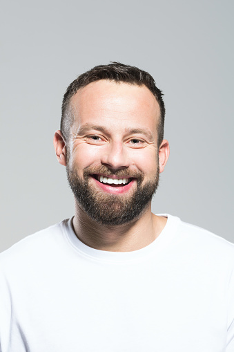 Headshot Of Excited Bearded Young Man Grey Background Stock Photo - Download Image Now