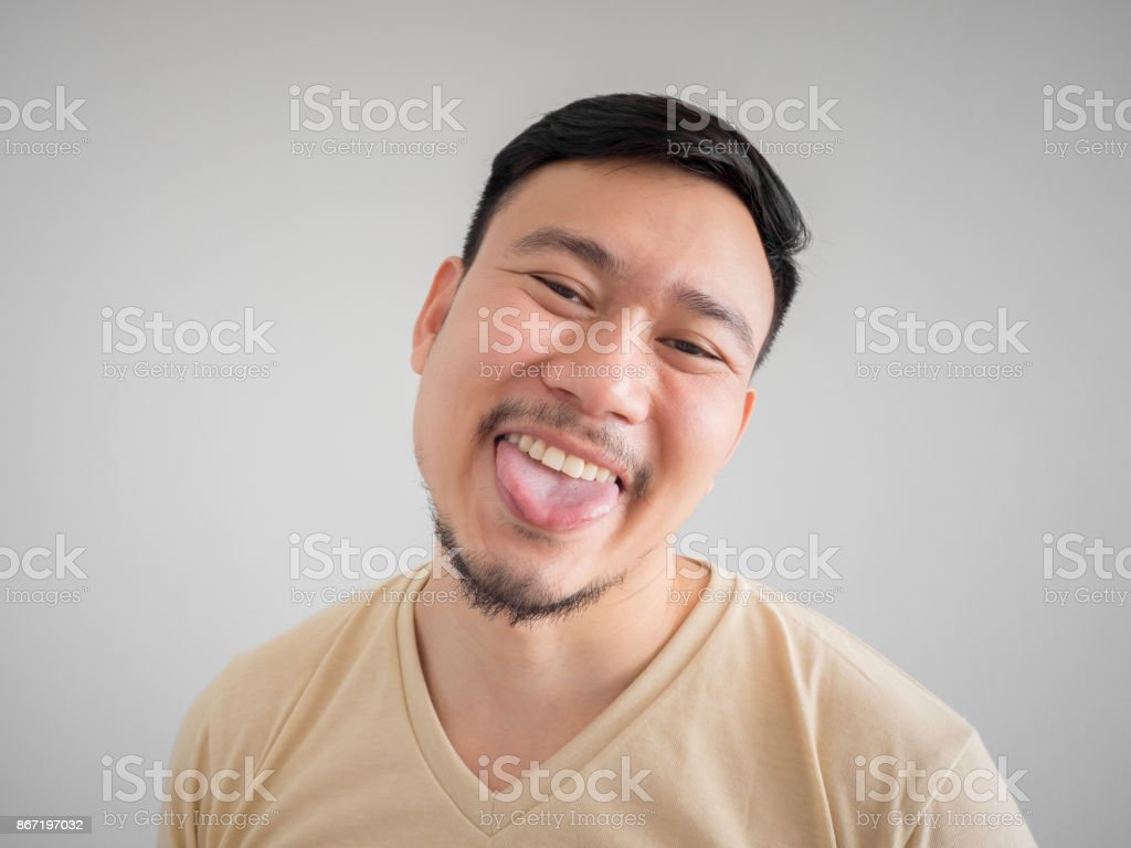 Headshot of funny guilty Asian man. stock photo
