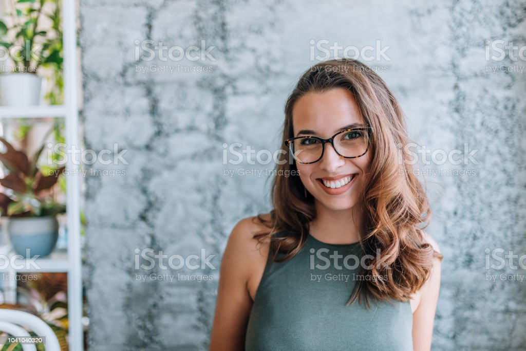 Headshot of gorgeous young woman with eyeglasses. stock photo