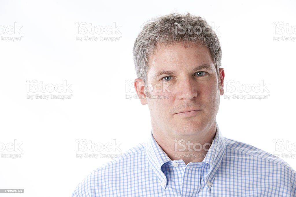 Headshot of Serious Middle Aged Caucasian Man with Gray Hair stock photo