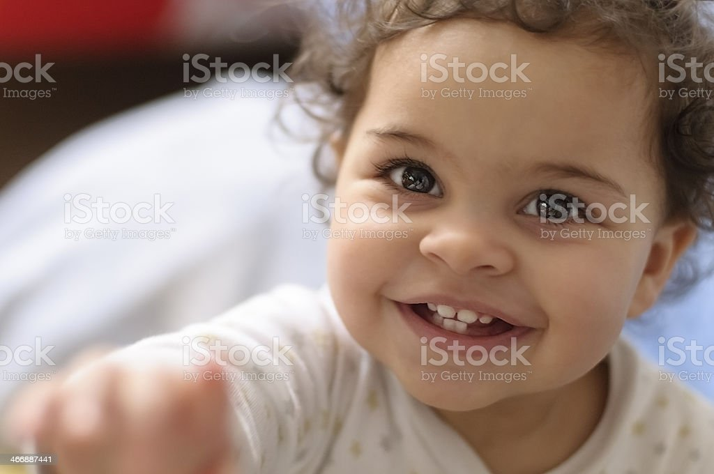 Headshot of Smiling Baby Girl Royalty free stock photo of 2 years old baby girl headshot. This file has a signed model release. Shot in RAW, post processed in Prophoto RGB, no sharpening applied. 12-17 Months Stock Photo