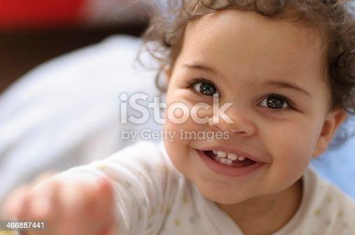 istock Headshot of Smiling Baby Girl 466887441
