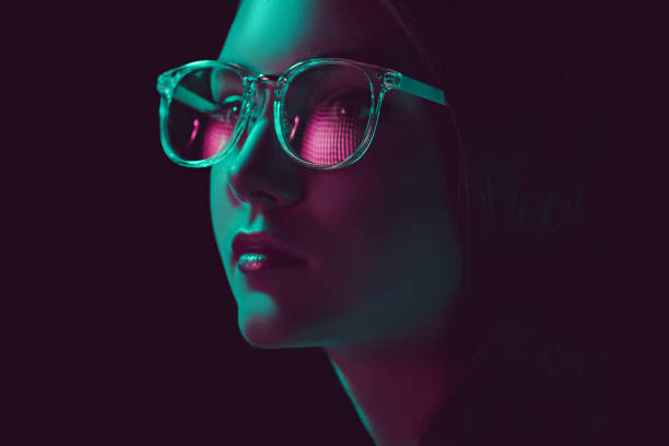 headshot of stylish young woman in sunglasses looking away stock photo