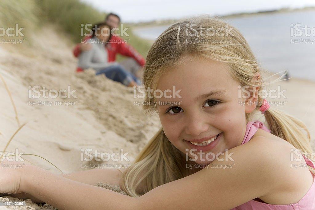 Headshot of Young Girl Lying on Beach stock photo
