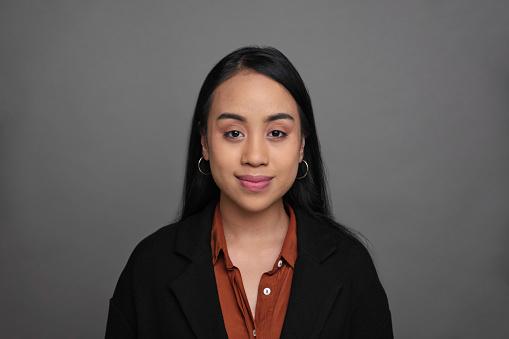 Headshot portrait of a young Filipino woman.