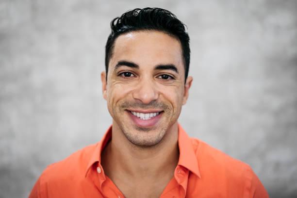Headshot portrait of happy mid adult Hispanic businessman stock photo