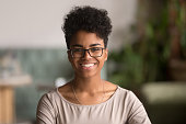 istock Headshot portrait of happy mixed race african girl wearing glasses 1144287292