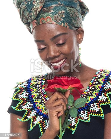 istock Headshot / profile view of 20-29 years old african ethnicity / african-american ethnicity female / young women in front of white background wearing headscarf / dress / traditional clothing who is love - emotion / smiling / happy / cheerful 1172564071