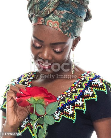 istock Headshot / profile view of 20-29 years old african ethnicity / african-american ethnicity female / young women in front of white background wearing headscarf / dress / traditional clothing who is love - emotion / smiling / happy / cheerful 1172564730