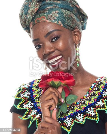 istock Headshot / profile view of 20-29 years old african ethnicity / african-american ethnicity female / young women in front of white background wearing headscarf / dress / traditional clothing who is love - emotion / smiling / happy / cheerful 1172564734