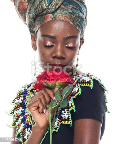 istock Headshot / profile view of 20-29 years old african ethnicity / african-american ethnicity female / young women in front of white background wearing headscarf / dress / traditional clothing who is love - emotion / smiling / happy / cheerful 1172564746