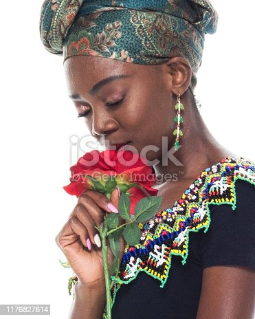 istock Headshot / profile view of 20-29 years old african ethnicity / african-american ethnicity female / young women in front of white background wearing headscarf / dress / traditional clothing who is love - emotion / smiling / happy / cheerful 1176827614