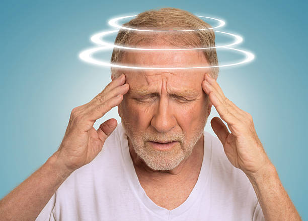 Headshot senior man with vertigo suffering from dizziness stock photo