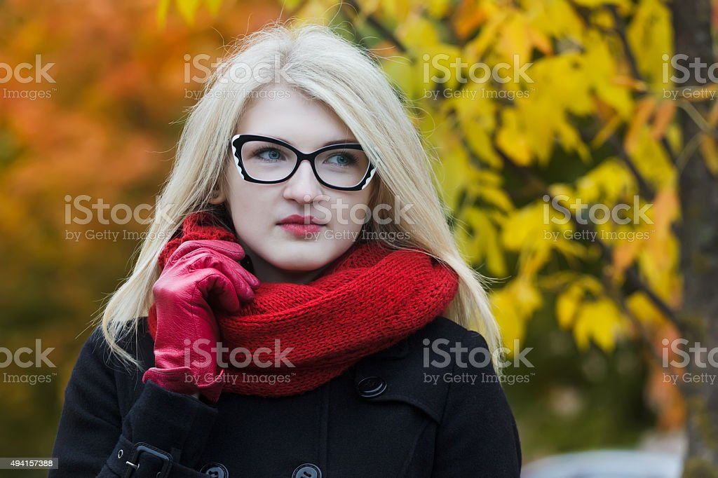 Headshot woman portrait with cat eye glasses and red glove stock photo
