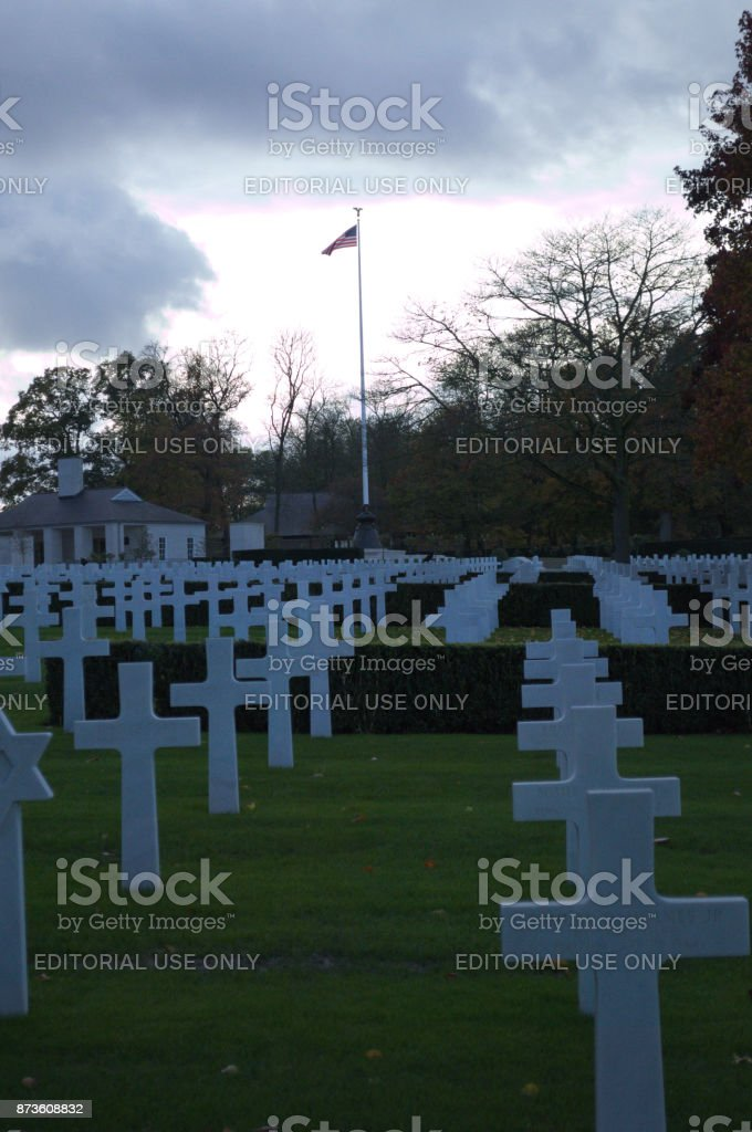 Headstones in a row with Flag in background stock photo