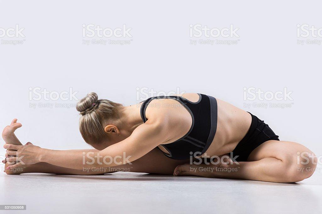 Head-to-Knee forward bend pose stock photo