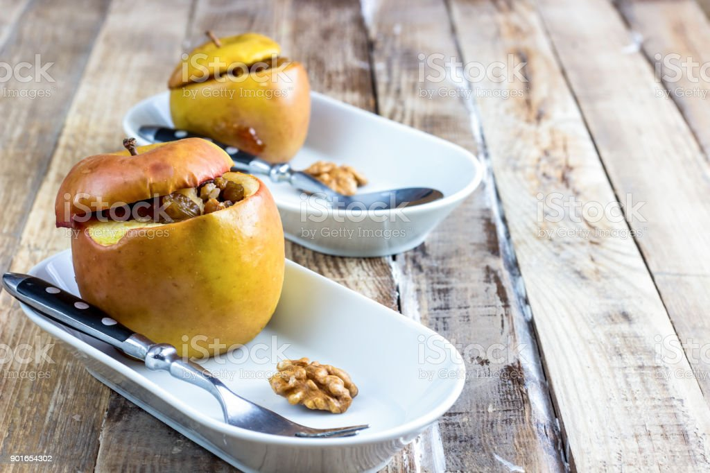 Healhty dessert baked red apples stuffed with granola stock photo