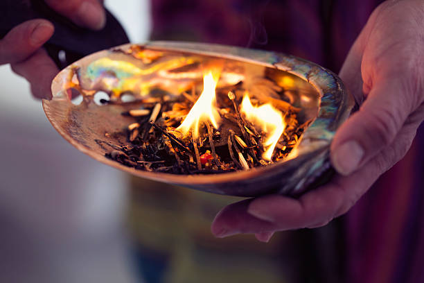 healing ceremony: burning incense in a shell - ceremonie stockfoto's en -beelden