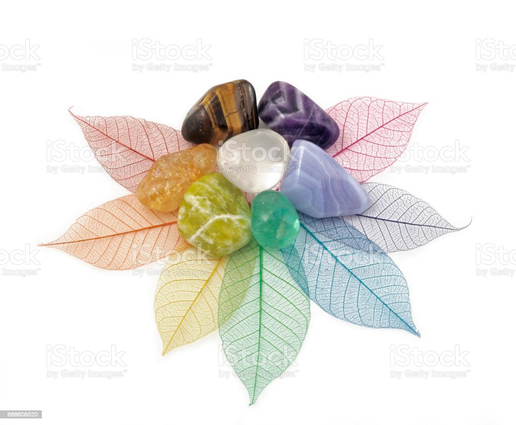 Healing Chakra Crystals on Leaves stock photo