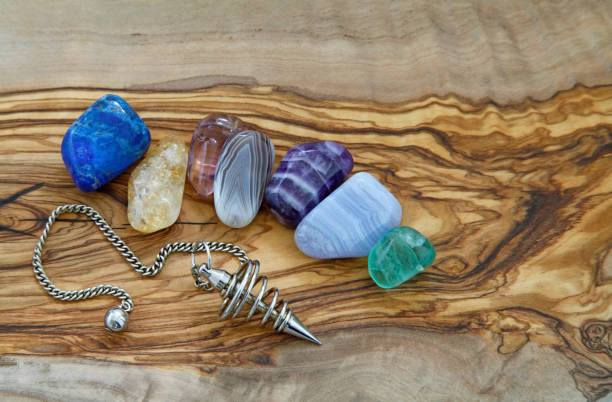healing crystals and dowsing pendant - pendulum stock photos and pictures