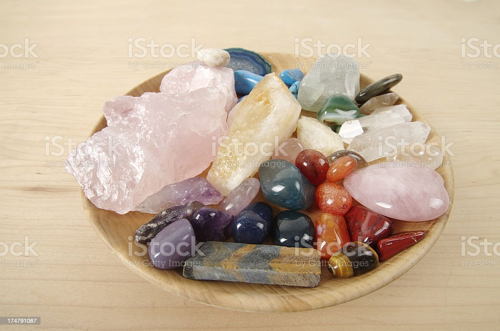 Healing Crystals in Wooden Dish stock photo