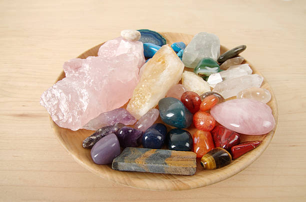 Healing Crystals in Wooden Dish Healing crystals of various types in a wooden dish. crystal healing stock pictures, royalty-free photos & images