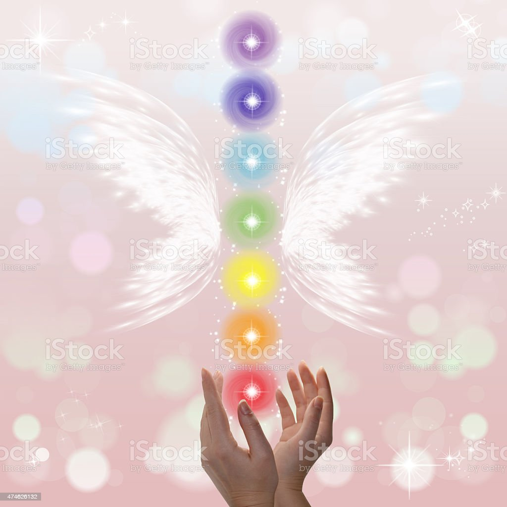 Healing Hands and seven chakras stock photo