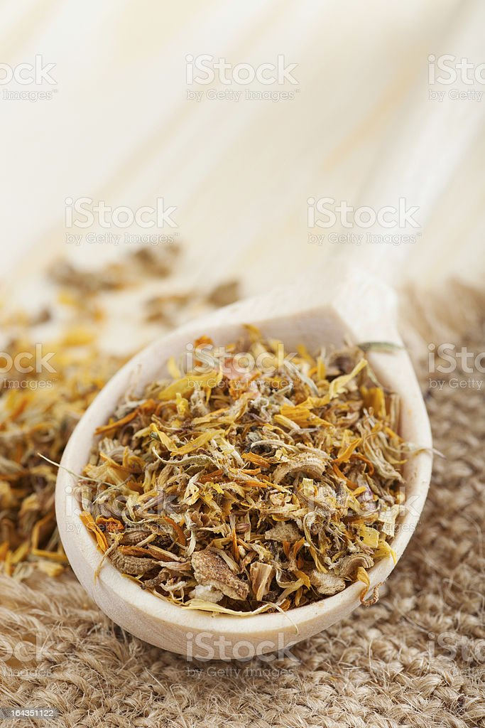 healing herbs in wooden spoon on table royalty-free stock photo