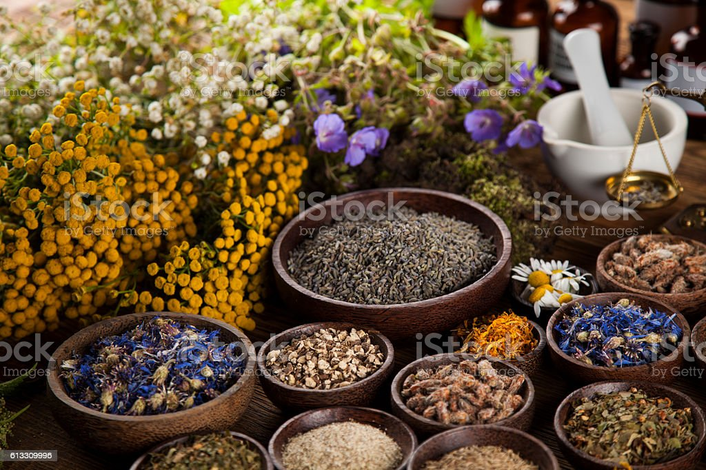 Foto de Healing Herbs On Wooden Table Mortar And Herbal