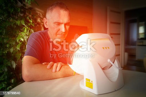 istock Healing pain with infrared light therapy 1279799540