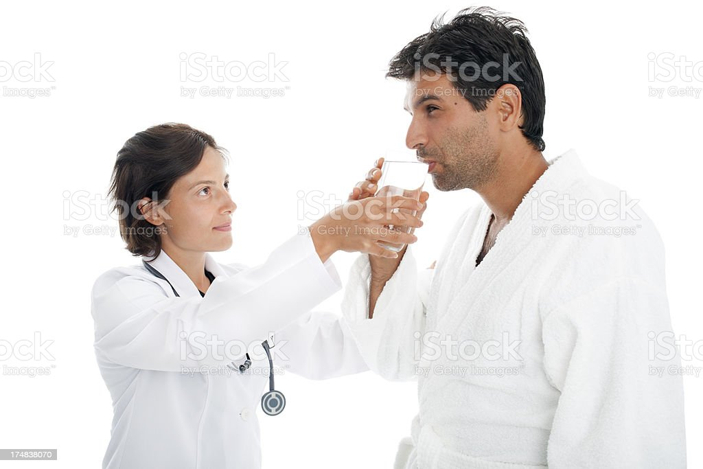 Healtcare worker gives the patient a glass of water stock photo