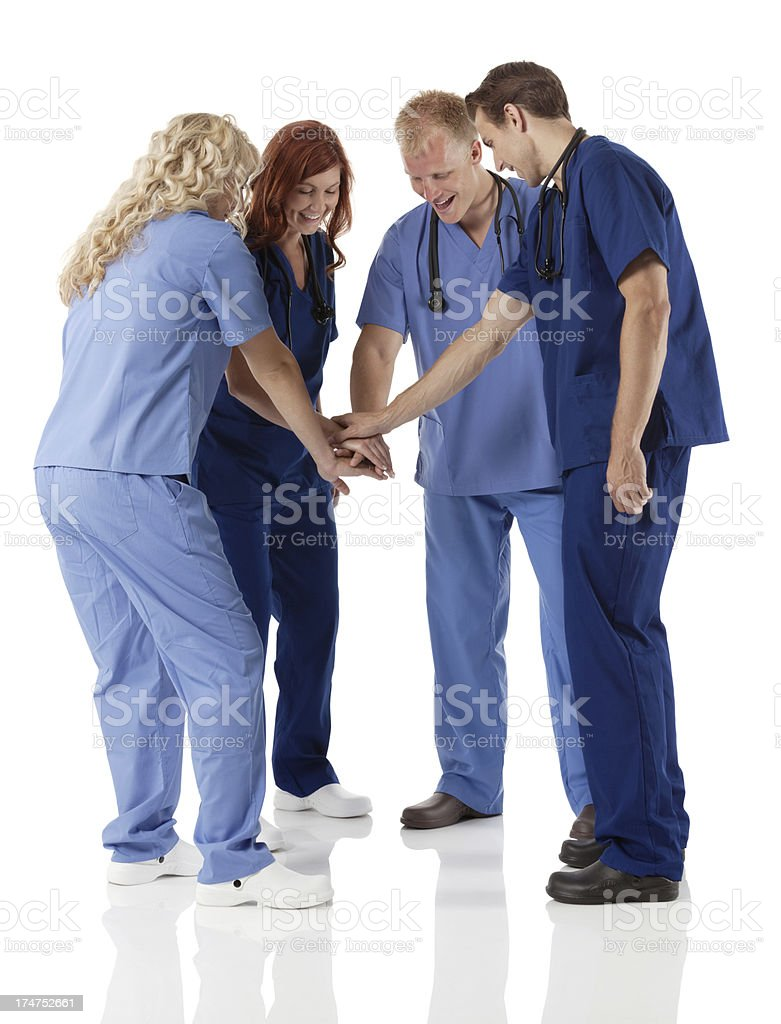 Healtcare workers stacking hands together stock photo
