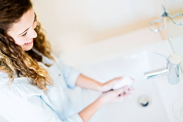health and hygiene begin with handwashing! - handwashing stock photos and pictures