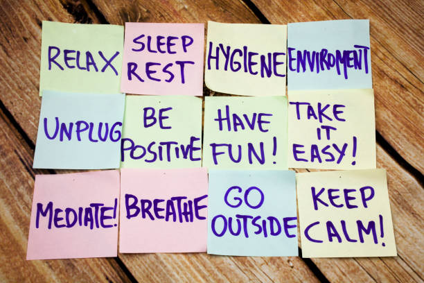 Health and positive handwritten notes on the papers with retro wooden bark background. Flat lay image of health handwritten notes. Sport and fitness positive handwritten messages. stock photo
