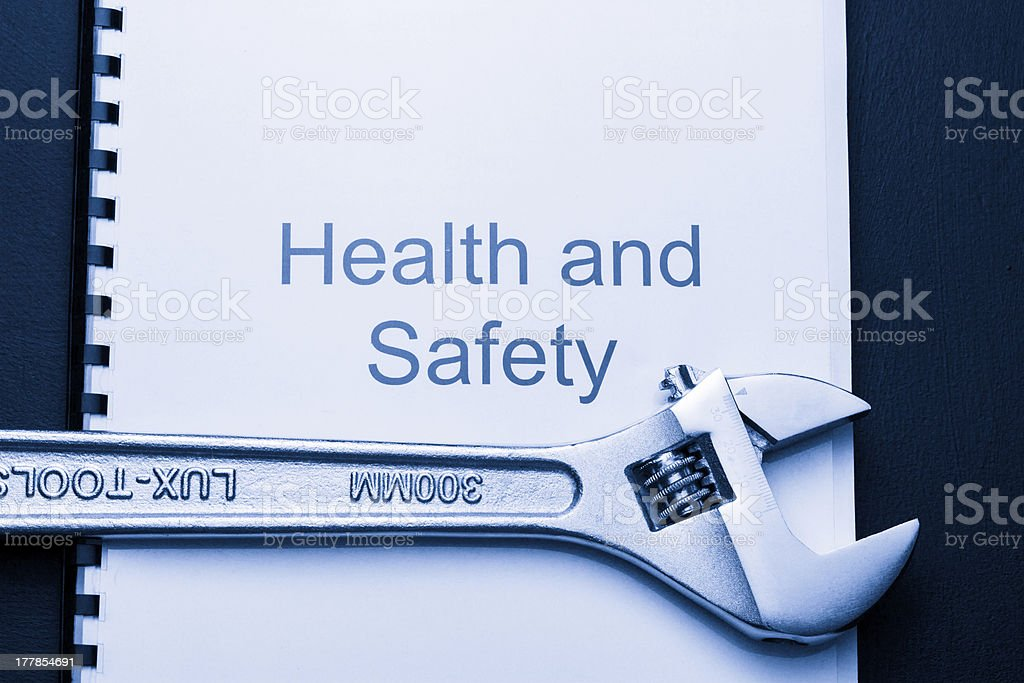 Health and safety register with spanner royalty-free stock photo