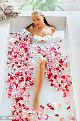 istock Health, Beauty. Woman Spa Body Care. Relaxing Flower Rose Bath 530749600