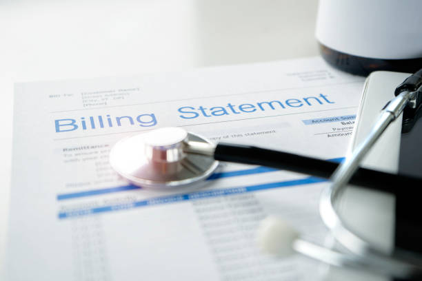 Health care billing statement. Health care billing statement with stethoscope, bottle of medicine for doctor's work in medical center stone background. expense stock pictures, royalty-free photos & images