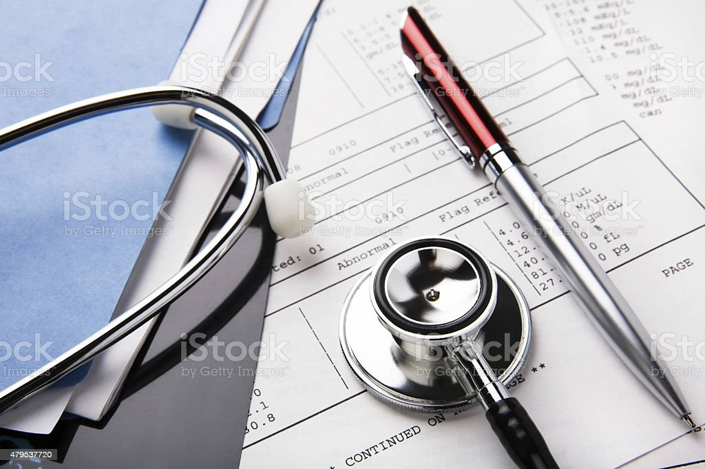 Health care billing statement with stethoscope stock photo