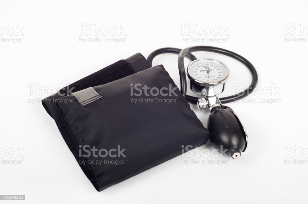 Health care concept - blood preasure cuff, monitor and stethoscope on white background stock photo