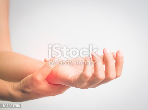 istock health care concept. Close up woman holding her wrist symptomatic Office Syndrome. Pain in the joints of the hands. Carpal tunnel syndrome. 825424756