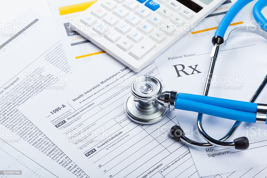 Health care costs. Stethoscope and calculator stock photo
