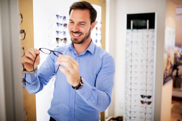 Health care eyesight and vision concept happy man choosing glasses at picture id1179731201?b=1&k=6&m=1179731201&s=612x612&w=0&h=k6kawytxu3ki2m9vu0br6cndgu6cx6d thsw buabe8=