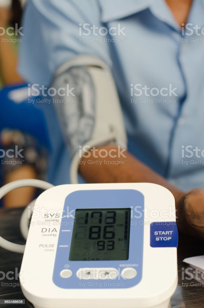 Health care for men with rhythm and blood pressure monitors stove. stock photo