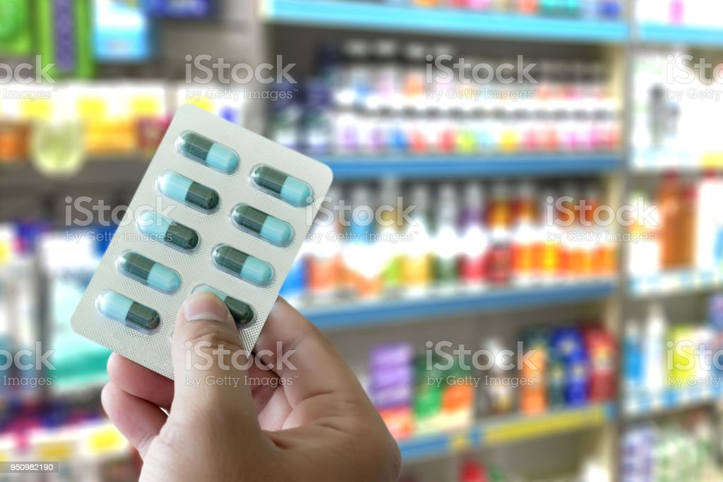 health care holding at drugstore Pack birth control pills pharmacy...